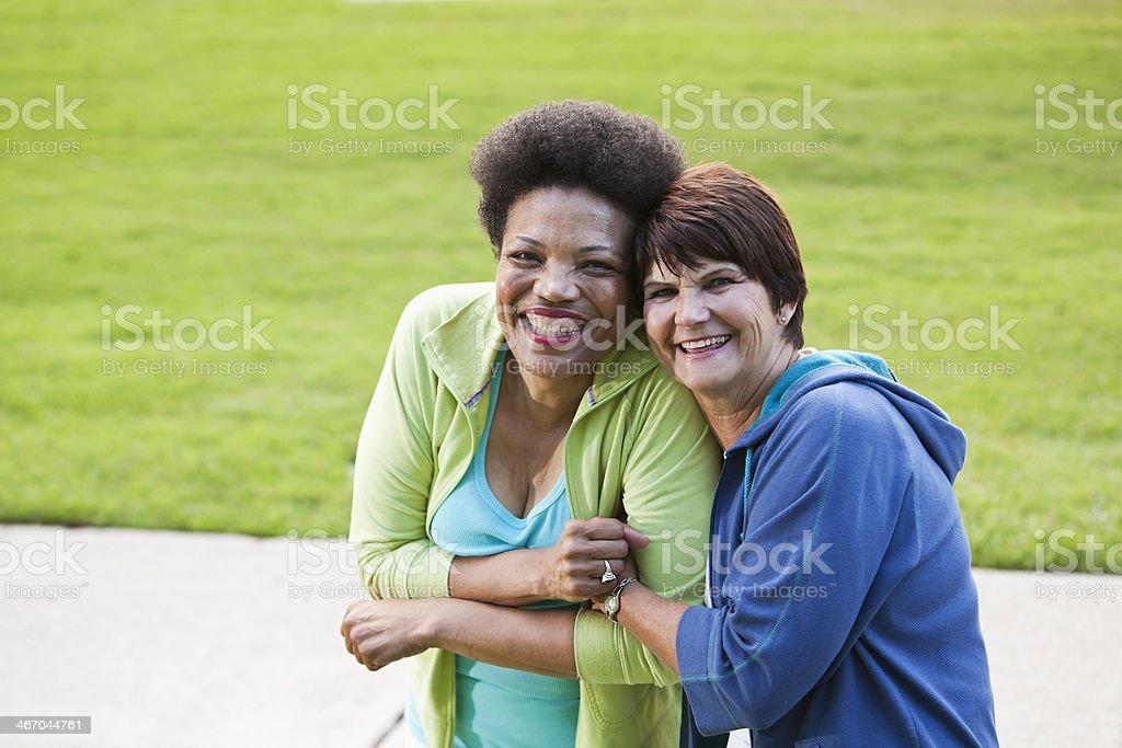 Mature women, friends stock photo