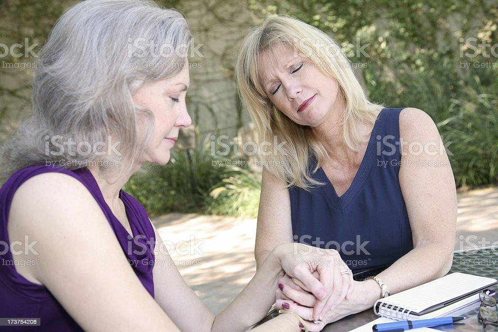 Mature Women Praying Together royalty-free stock photo