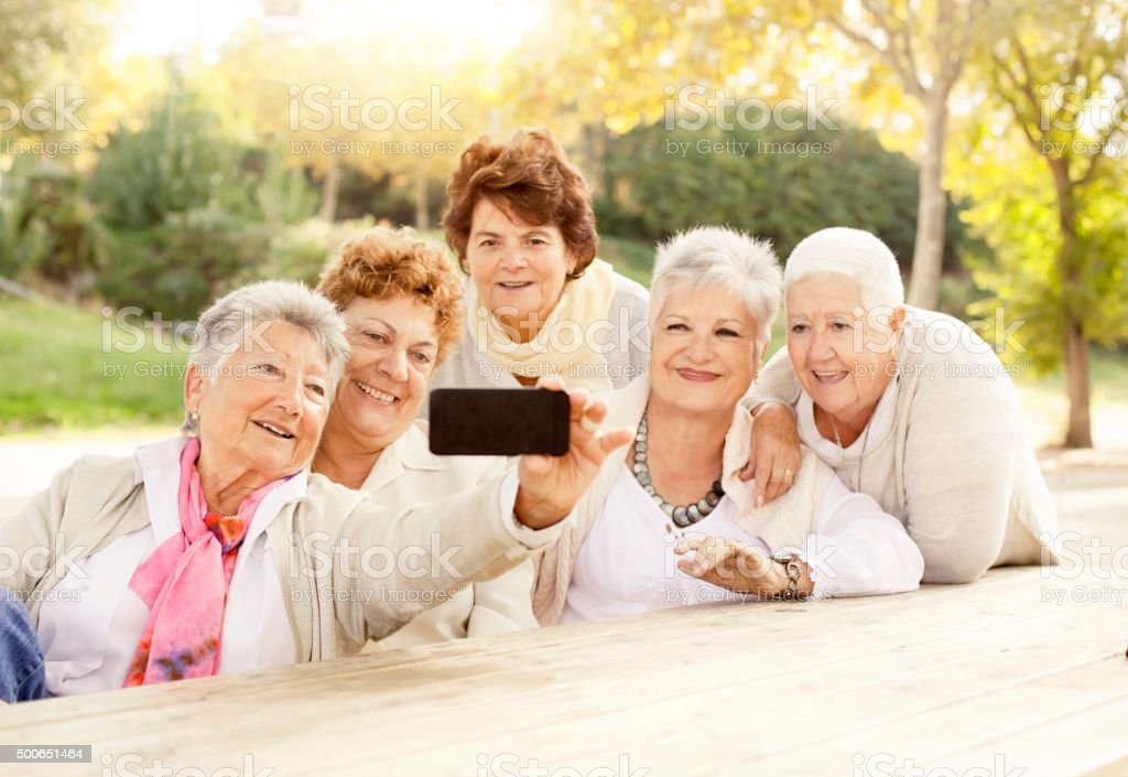 Mature women taking a Selfie stock photo