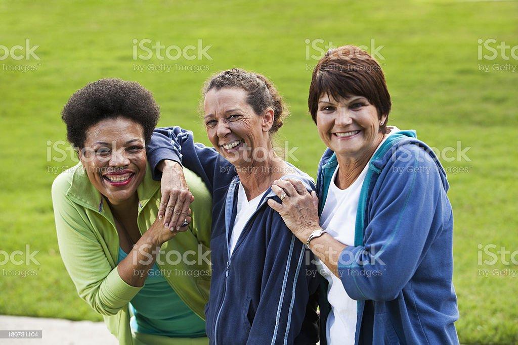 Mature women wearing sweatsuits outdoors stock photo