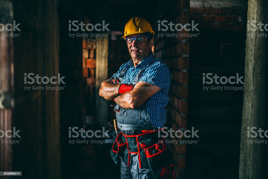 Mature worker with tool belt stock photo