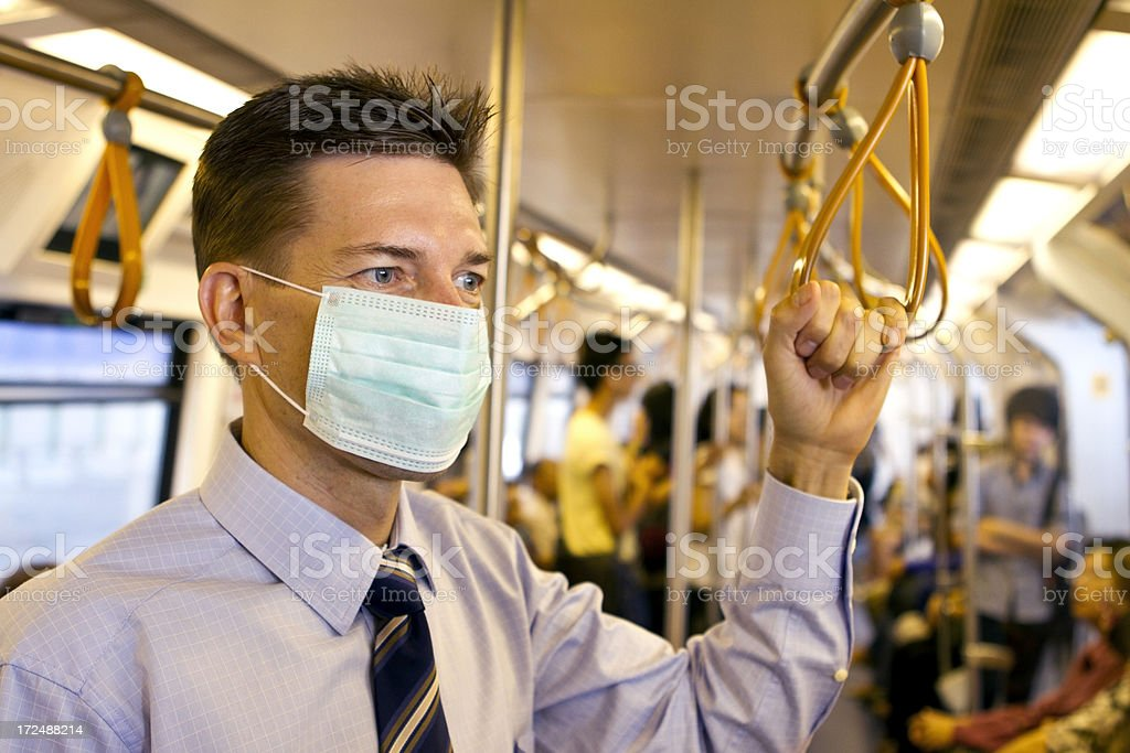 Matured business man wearing a protective mask in subway stock photo