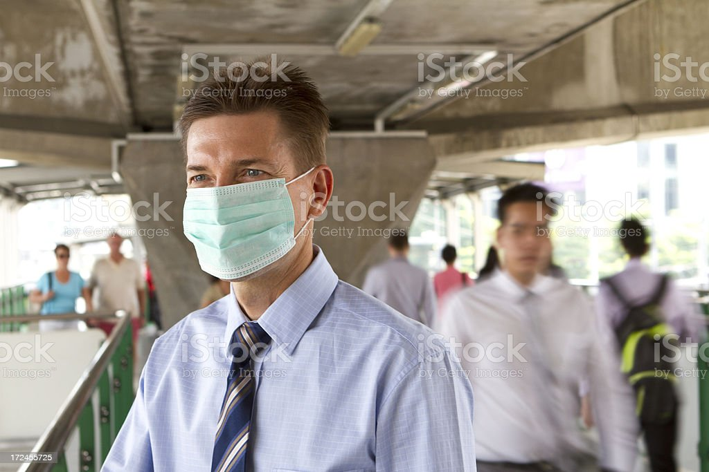 Matured business man wearing a protective mask stock photo