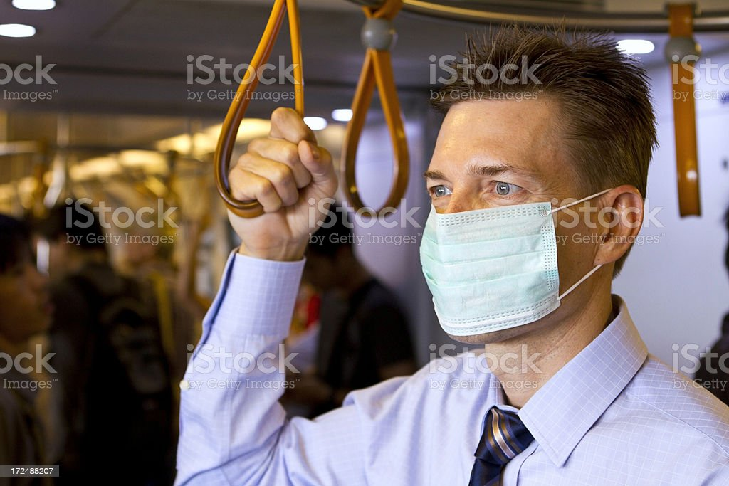 Matured business man wearing protective mask in train royalty-free stock photo