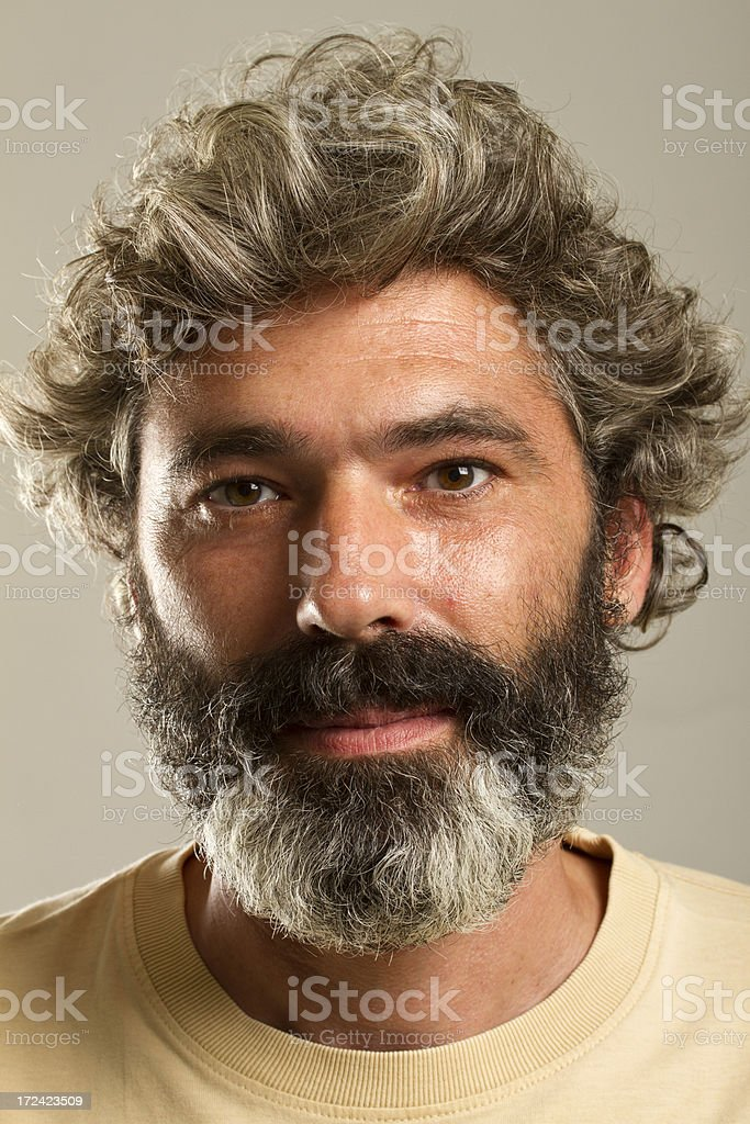 Matured man with beard and curly hair royalty-free stock photo