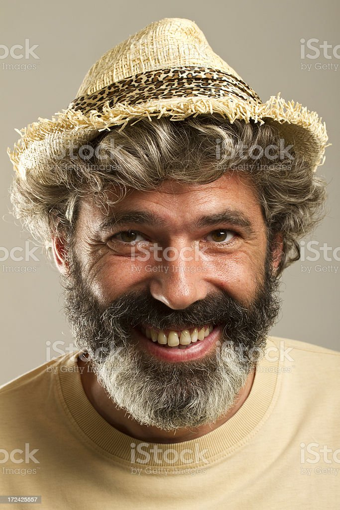 Matured man with beard and curly hair smiling royalty-free stock photo