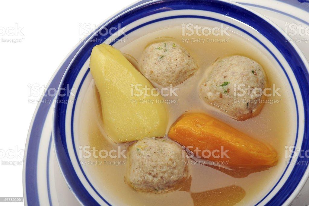 Matzah ball soup - over white royalty-free stock photo