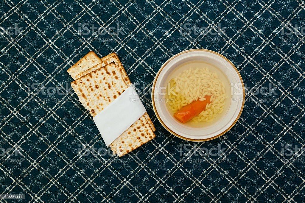 Matzah balls in a bowl of soup stock photo