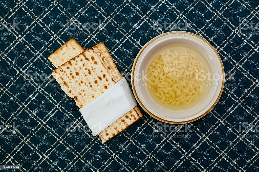 Matzah balls in a bowl of soup stock photo