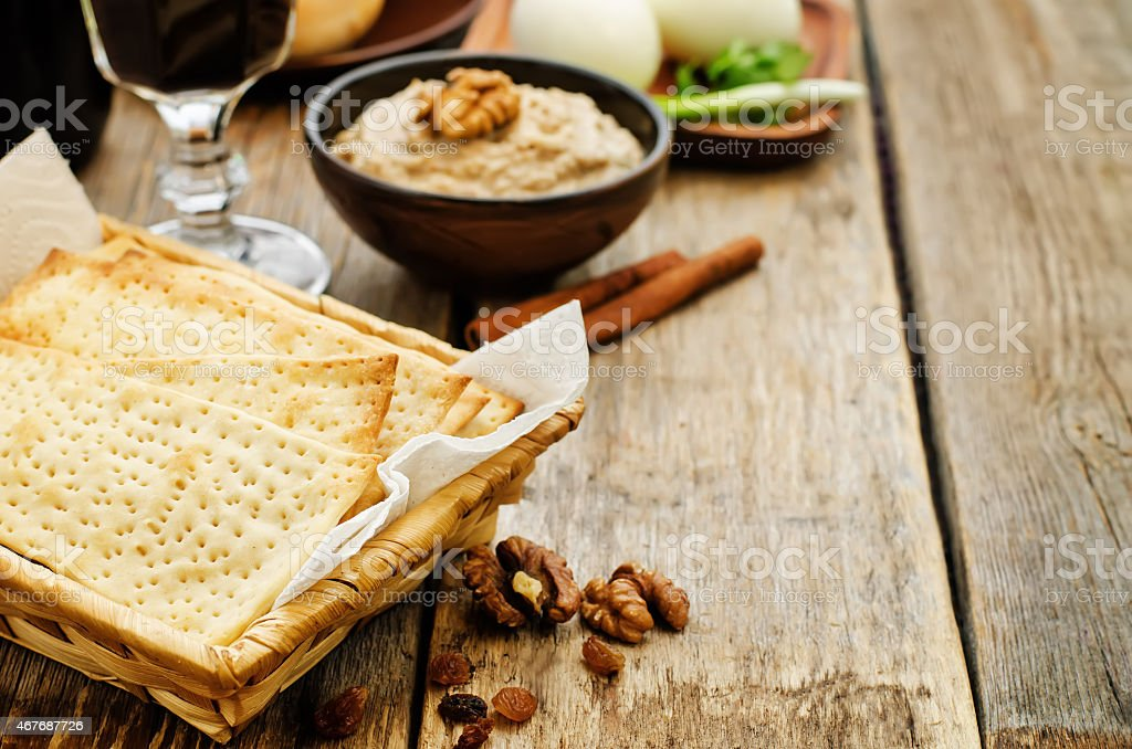 Matzah, wine, eggs, chicken, greens and haroset stock photo