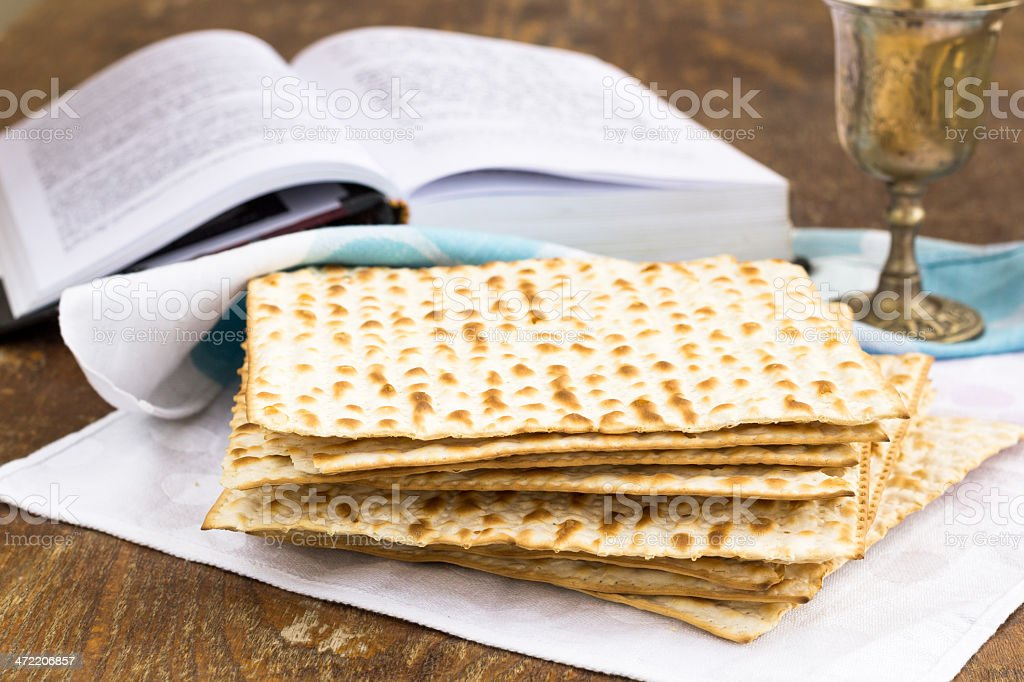Matzo and wine for passover celebration on a wooden table stock photo