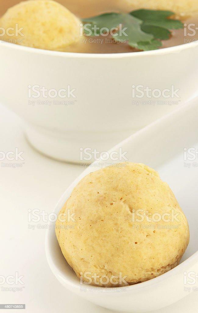 Matzo ball on soup ladle royalty-free stock photo