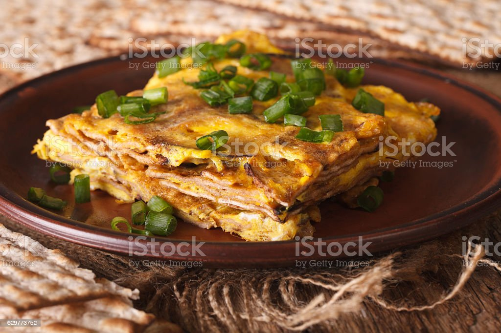 Matzo fried with eggs and green onions - matzah brei stock photo