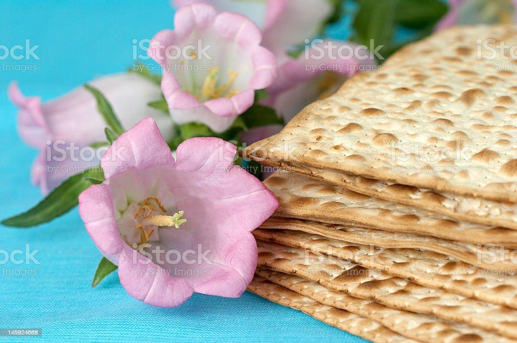 matzo. jewish passover bread with flowers stock photo