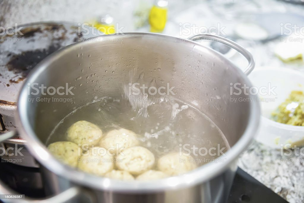 Matzoh balls cooking in a pot royalty-free stock photo