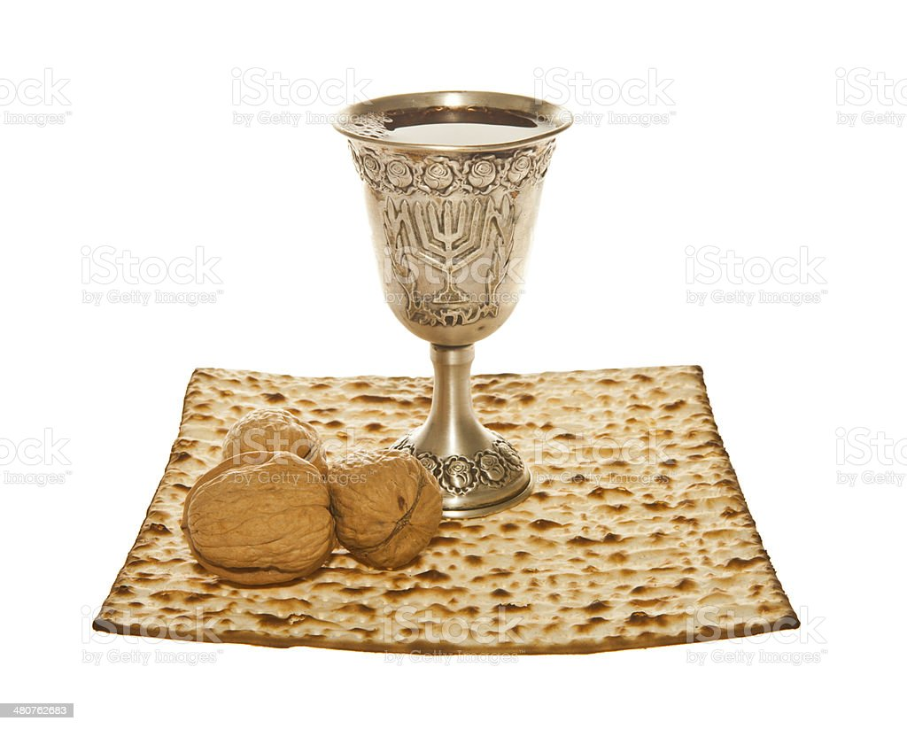 Matzoth, silver Kiddush cup and three walnuts royalty-free stock photo