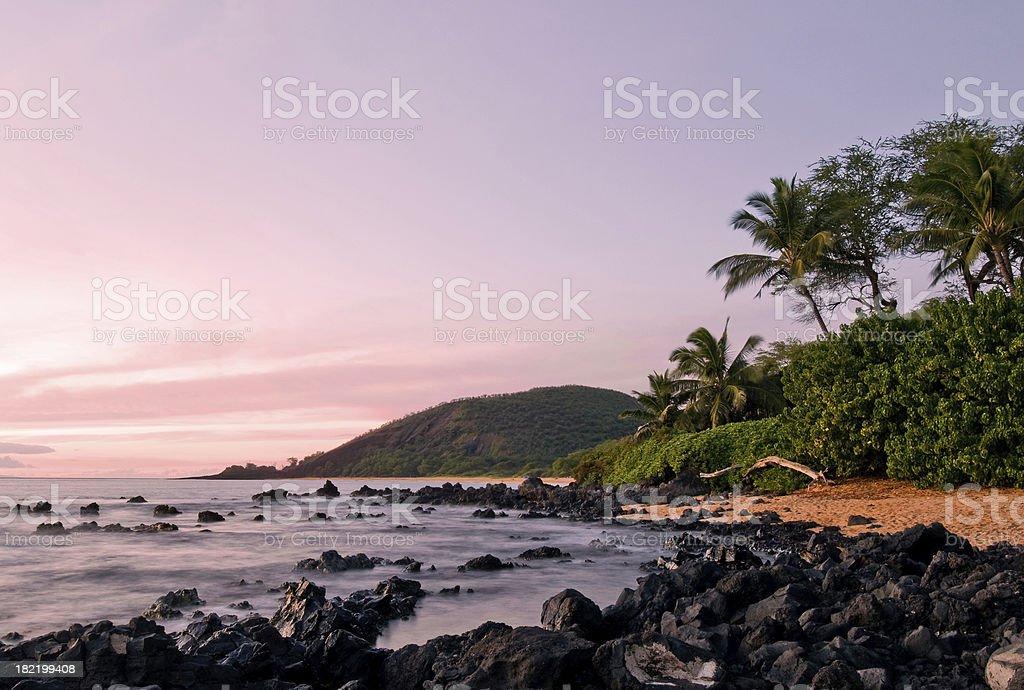 Maui beach lit by sunset stock photo