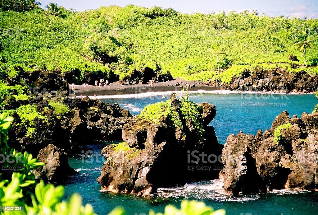 Maui black sand beach scene at Waianapanapa stock photo