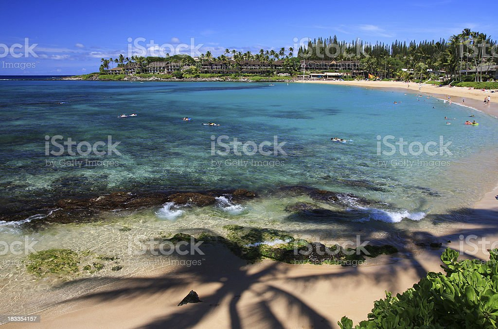 Maui Hawaii Beach ocean front hotel resort and swim snorkelers stock photo