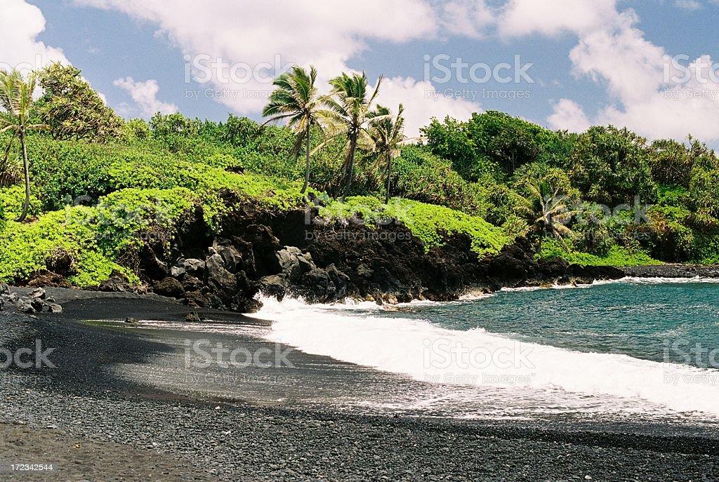 Maui Hawaii black sand beach at Waianapanapa State Park stock photo