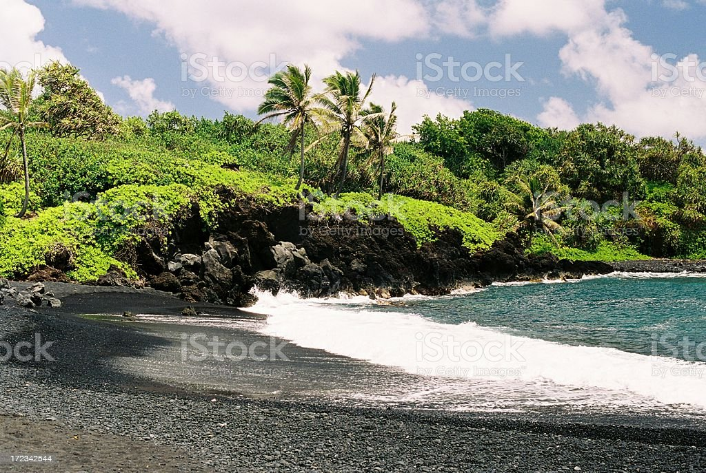 Maui Hawaii black sand beach at Waianapanapa State Park stock photo