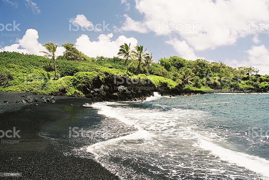 Maui Hawaii Black Sand Beach landscape and Palm Trees stock photo
