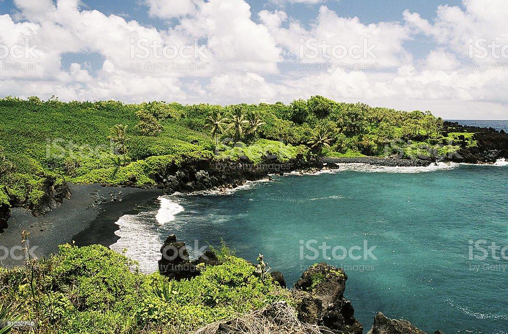 Maui Hawaii black sand beach scenic stock photo