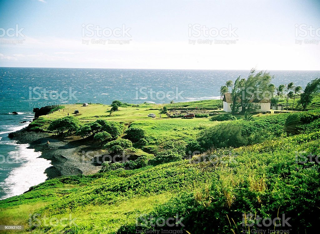 Maui Hawaii church and black sand beach Pacific ocean landscape stock photo