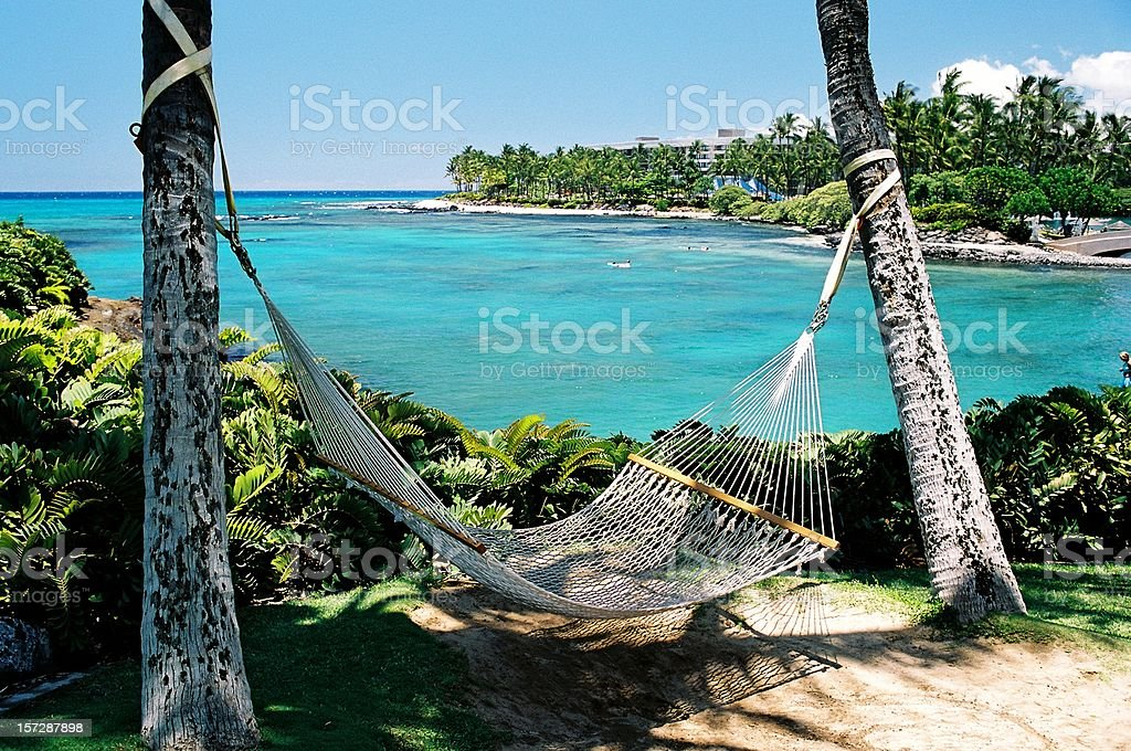 Maui Hawaii hammock on tropical turquoise resort hotel bay stock photo