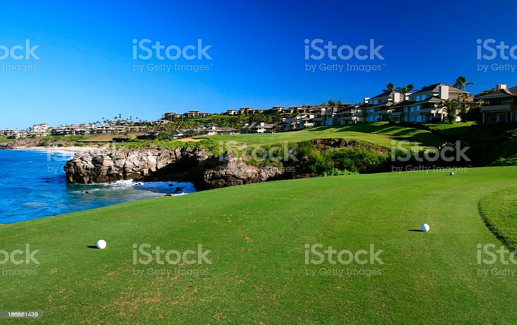 Maui Hawaii oceanfront resort hotel golf course hole stock photo