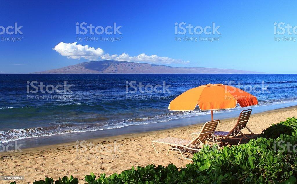Maui Hawaii Pacific ocean beach and lounge chairs royalty-free stock photo