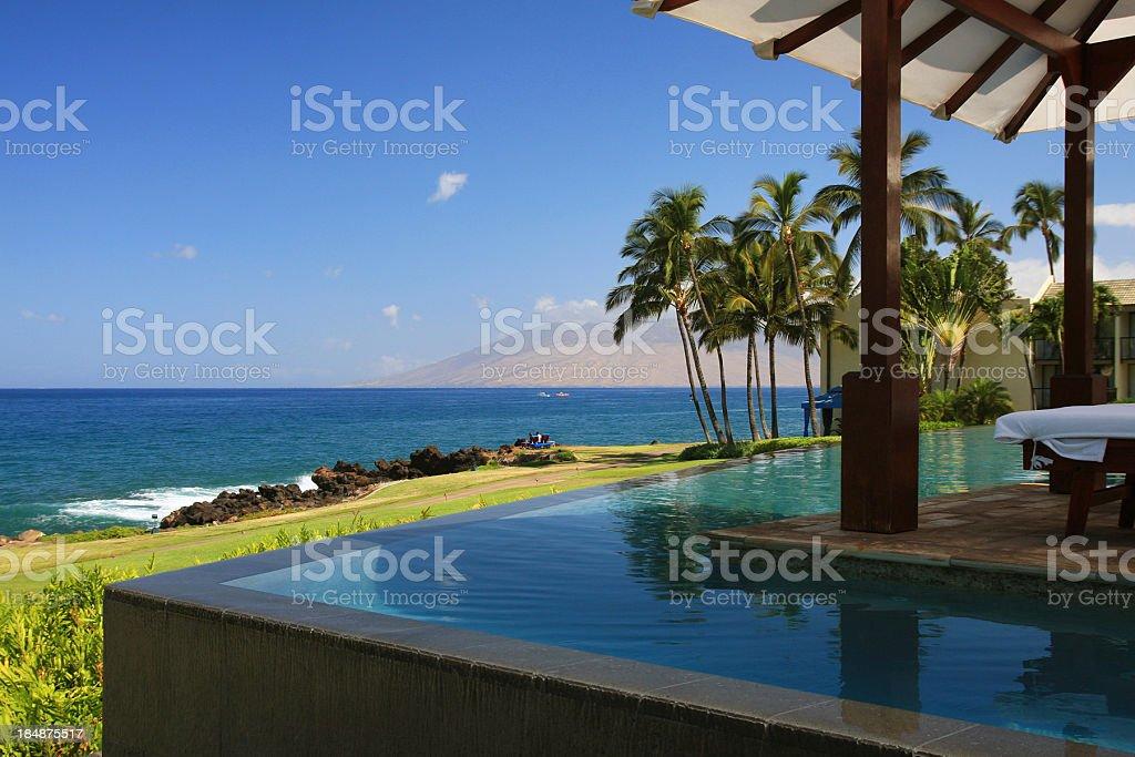 Maui Hawaii resort hotel infinity pool, Pacific ocean scenic stock photo