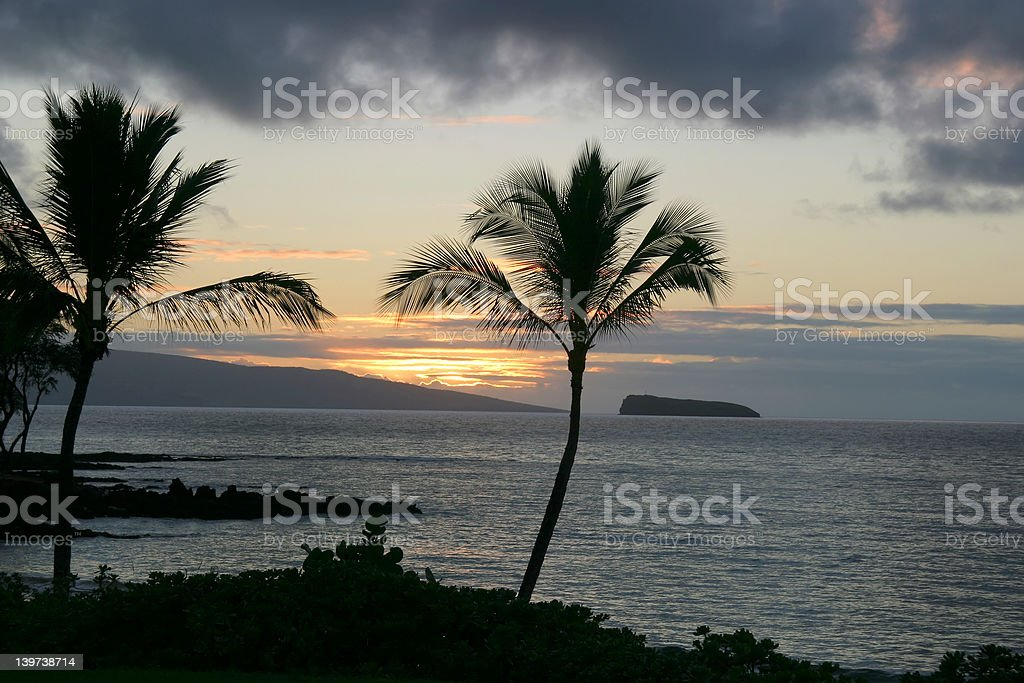 Maui sunset with Molokini Crater stock photo