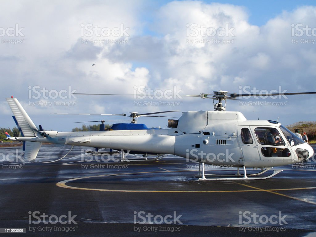 Maui WHite Helicopter on Heli Pad Cloudy Sunny Day Copter stock photo