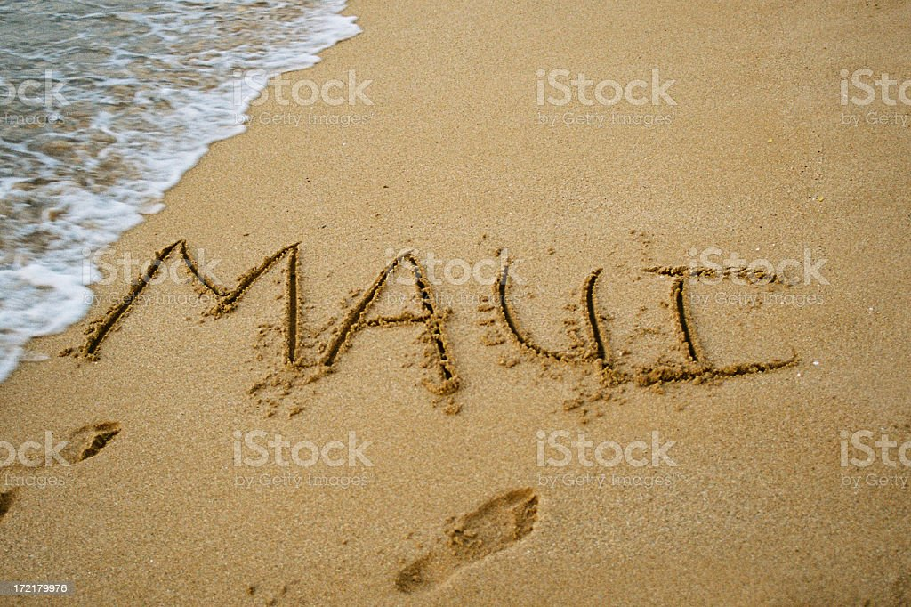 Maui written in Hawaii beach sand royalty-free stock photo