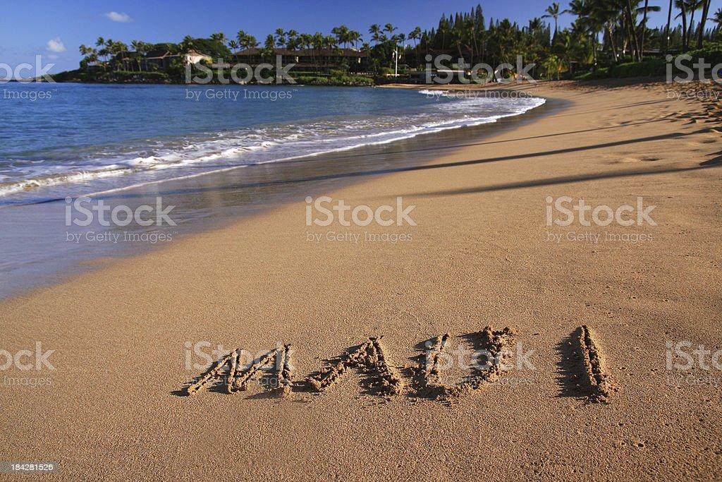 Maui written on Hawaii resort hotel sand beach royalty-free stock photo