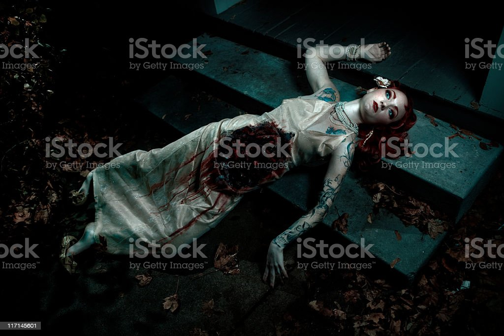 Mauled dead woman on steps stock photo