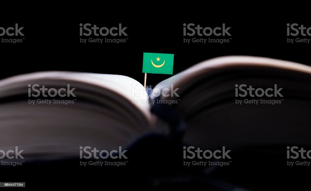 Mauritania flag in the middle of the book. Knowledge and education concept. stock photo