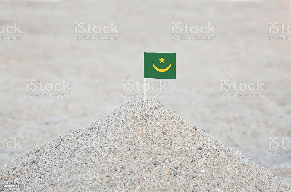 Mauritania Flag on the beach stock photo