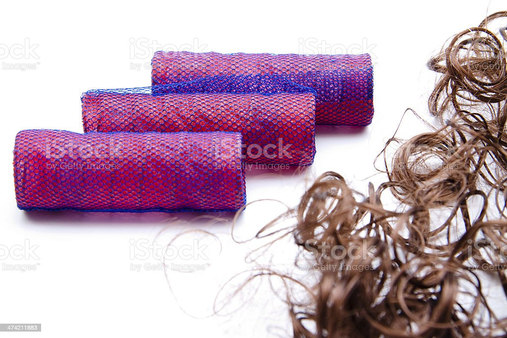 Mauve curler and hairpiece stock photo