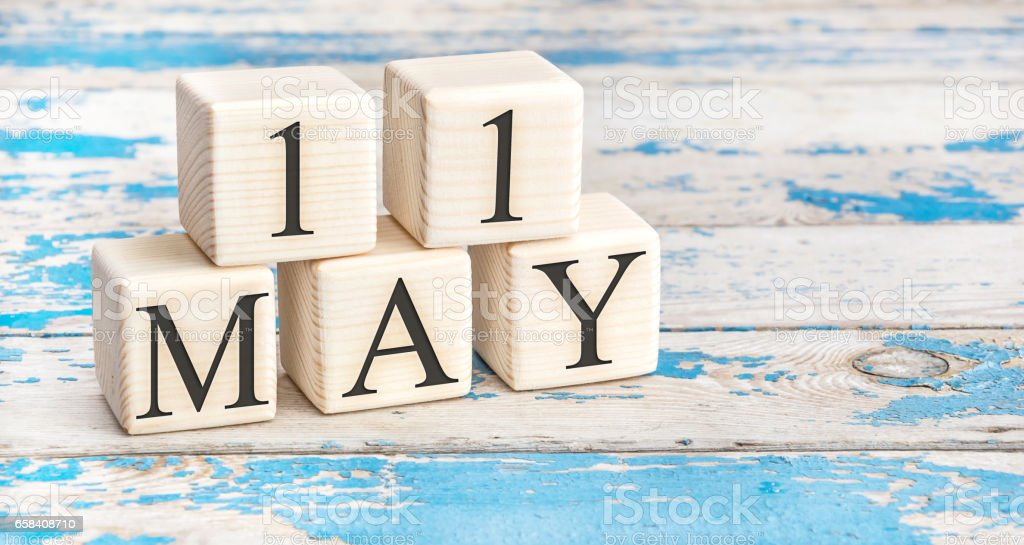 May 11th. Wooden cubes with date of 11 May on old blue wooden background. stock photo