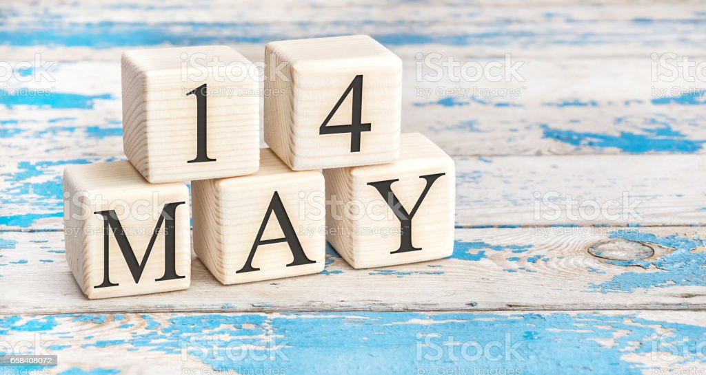 May 14th. Wooden cubes with date of 14 May on old blue wooden background. stock photo