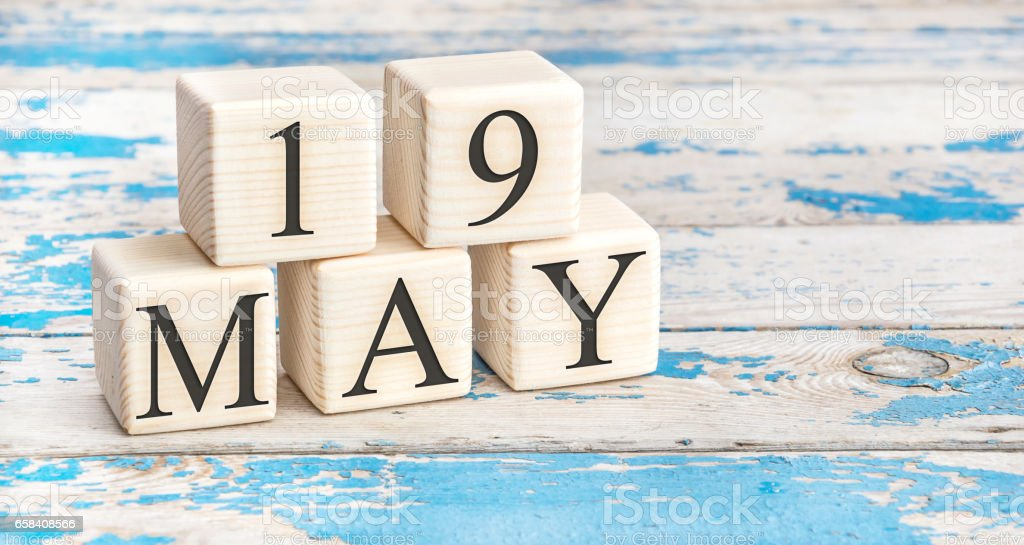 May 19th. Wooden cubes with date of 19 May on old blue wooden background. stock photo