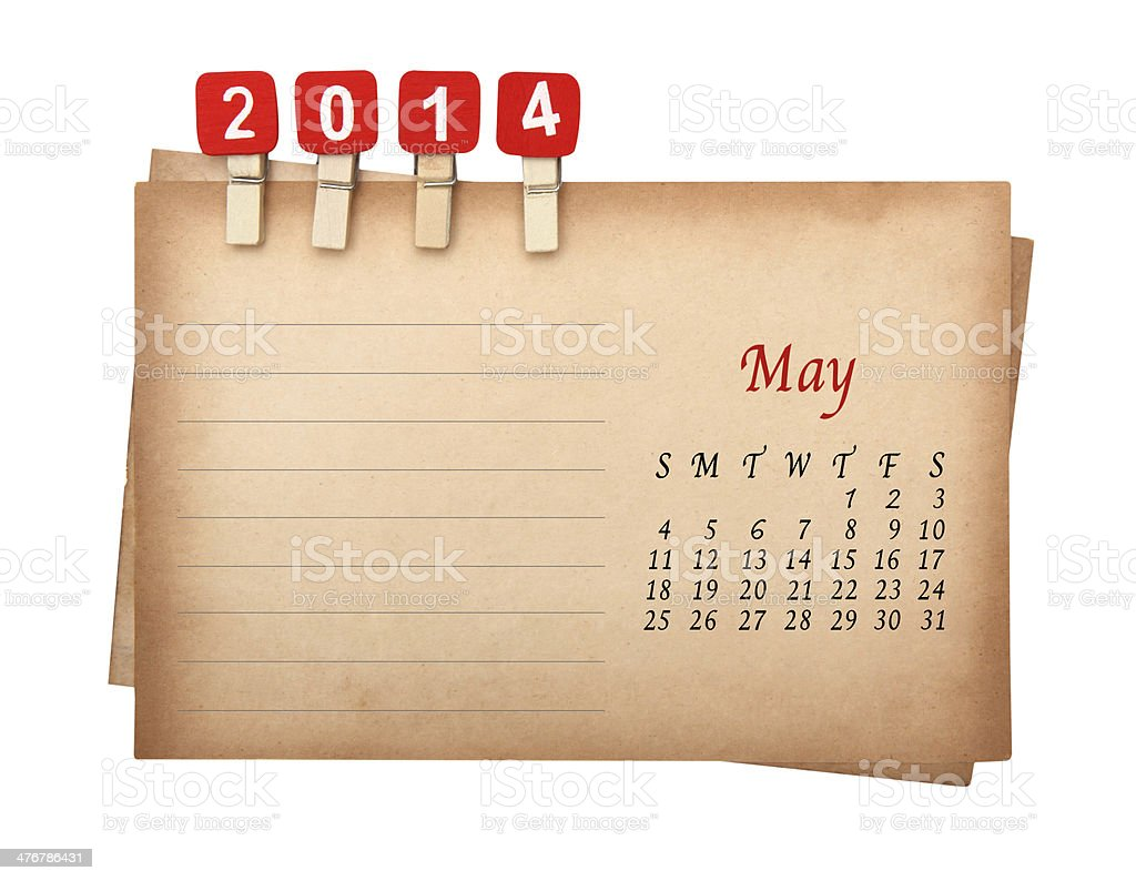 May 2014 calendar on the old paper with wooden pegs royalty-free stock photo