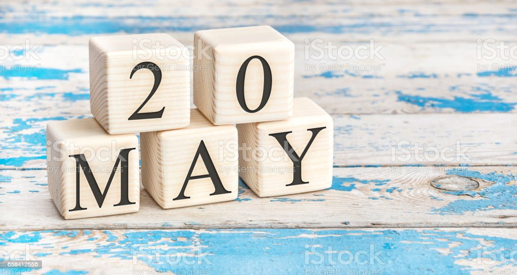 May 20th. Wooden cubes with date of 20 May on old blue wooden background. stock photo