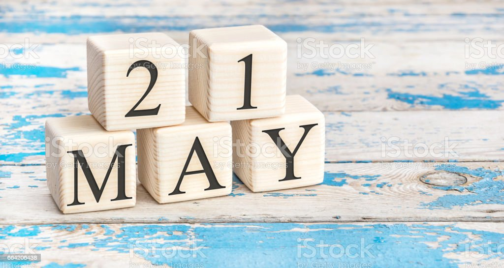 May 21st. Wooden cubes with date of 21 May on old blue wooden background. stock photo