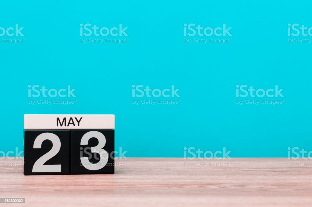 May 23rd. Day 23 of month, calendar on turquoise background. Spring time, empty space for text stock photo