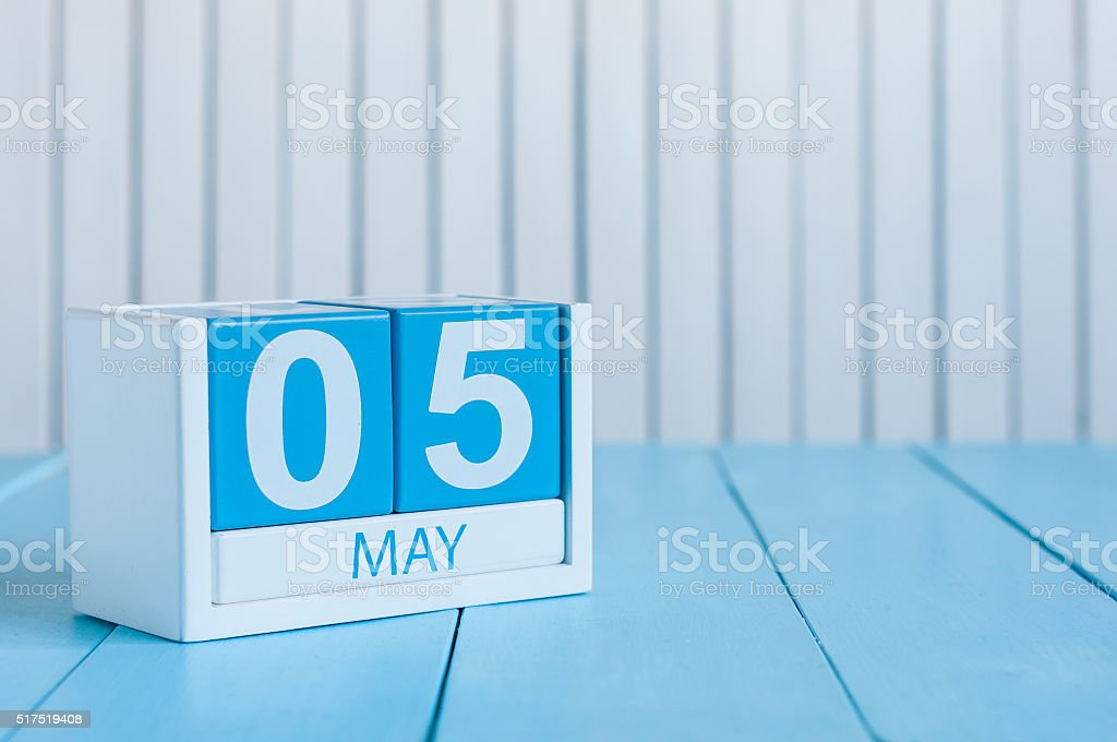 May 5th. Image of may 5 wooden color calendar on stock photo