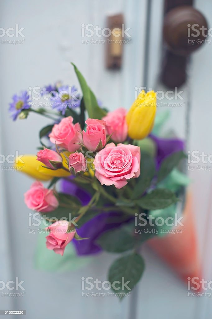 May Day Basket hangs on a doorknob stock photo