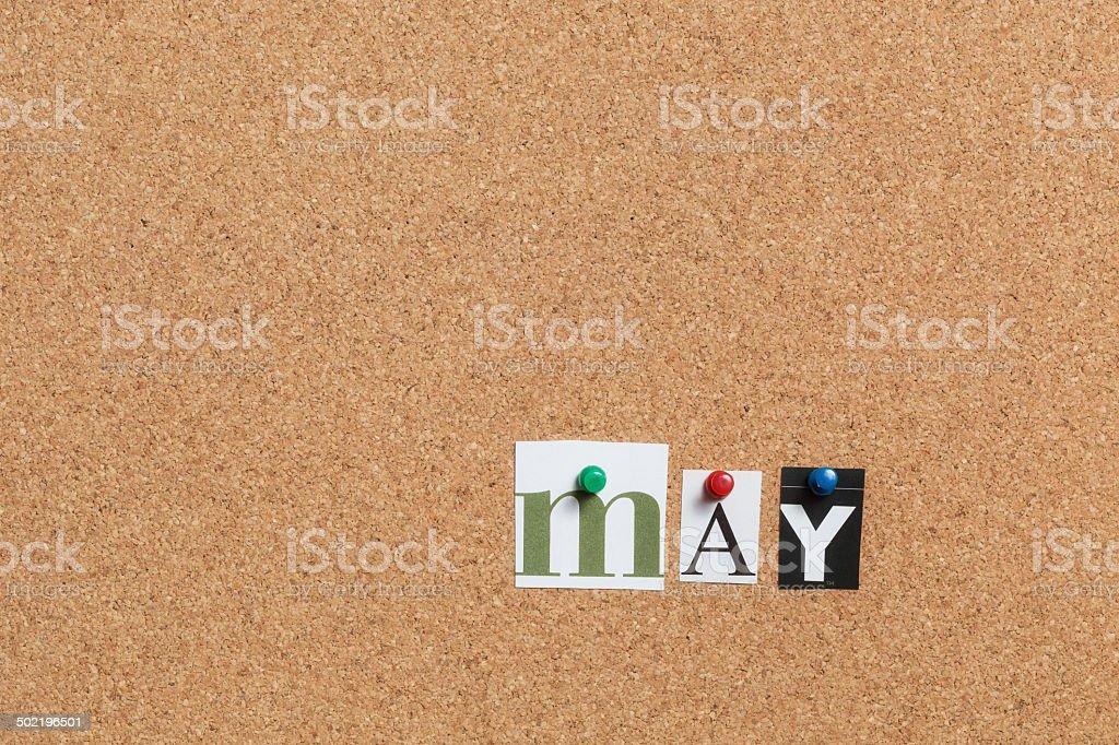 May pinned on bulletin cork board royalty-free stock photo